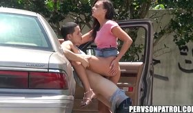 Teeny tiny gal gives blowjob on the parking lot