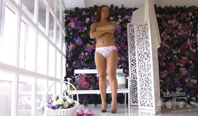 Tanned amateur peels off her panties on camera