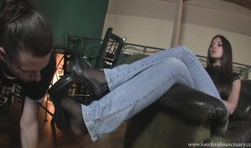 Foot fetish action with a dark-haired beauty in jeans and heels