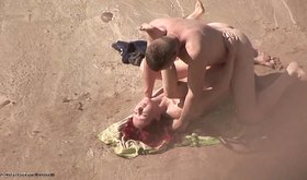 Redheaded naturist hottie gets fucked violently on the sand