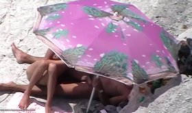 Crazy nudists enjoying a very sneaky sex session on a beach