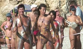 Various nudist babes posing with spears and looking like LARPers