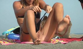 Perverted guy is watching smoking hot babes relaxing topless on beach