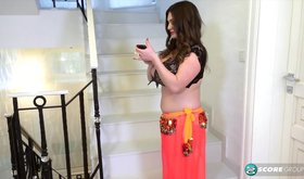 Insanely busty brunette is belly dancing right here and now