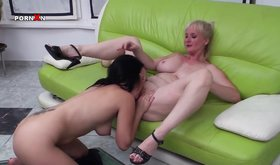 Older ladies are playing with a gigantic dildo on the couch