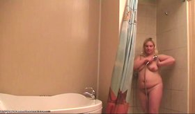 Chubby blonde shows her naked body while showering in HD